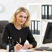 Woman business writing at desk.