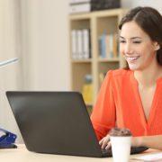 Beautiful freelancer providing freelance copywriting from her desk.