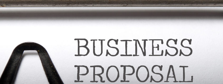 The term business proposal printed on an old typewriter